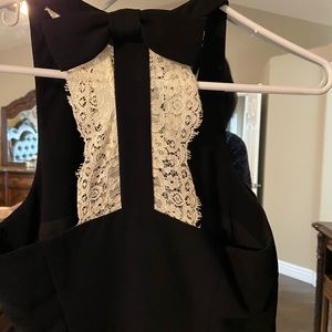 Black dress with bow and cream lace back